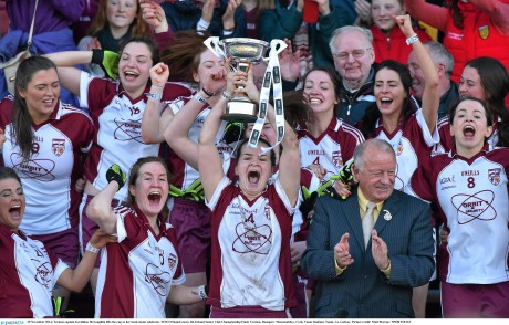 Termon captain Geraldine McLaughlin lifts the cup as her team-mates celebrate.