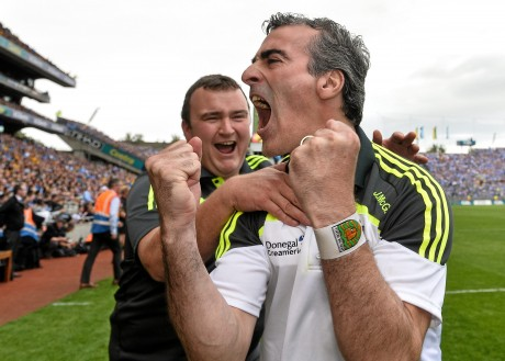 Donegal manager Jim McGuinness celebrates with kitman Joe McCloskey at the end of the All-Ireland semi-final.