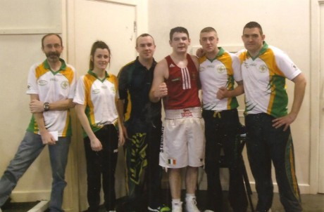 Paul Kelly, Twin Towns Boxing Club, with his coaches and team-mates after winning his semi final