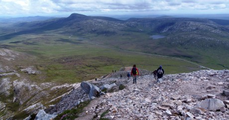 Climbers making their way down Errigal.