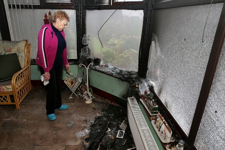 Hillary Russell surveys the damage to her home yesterday.