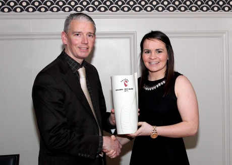 John Martin, Chairman UGAAWA, presents the Belleek Living Vase to November winner, Geraldine McLaughlin. Photo: Peadar McMahon