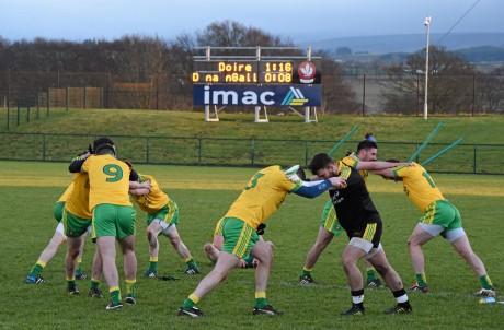 Donegal players warm down following their defeat to Derry.