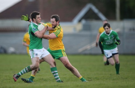 Donegal's Michael Murphy gets to grips with Fermanagh's Ryan Jones.