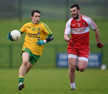 Eoin McHugh in action against Mark Lynch, Derry, in the Dr McKenna Cup.