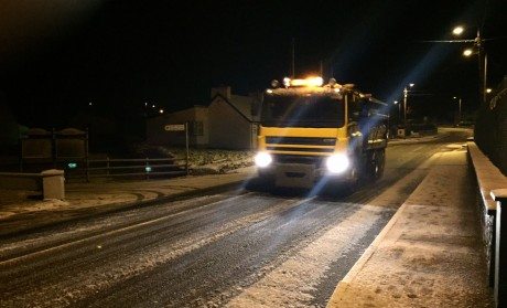 A council gritter on the N56 road at Loughanure just before midnight Saturday. Photo: Eoin McGarvey