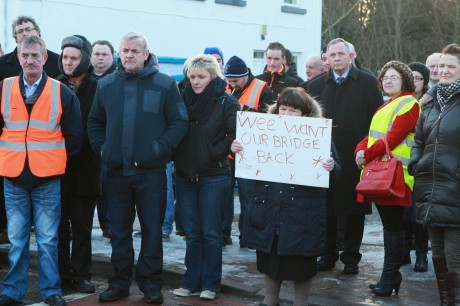 Mary Campbell with other protesters, as they assembled on Main Street, Glenties, yesterday afternoon. Photo: Brian McDaid