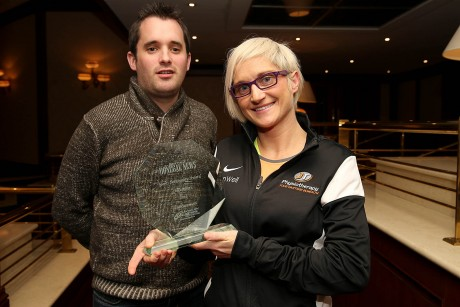 Ann Marie McGlynn receiving the Donegal News Sports Personality of the Month award for December 2014 from Chris McNulty, Donegal News.