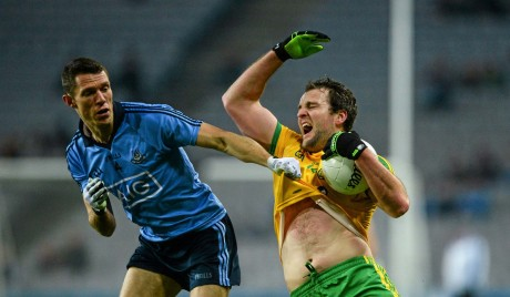 Michael Murphy, Donegal, in action against Daren Daly, Dublin.