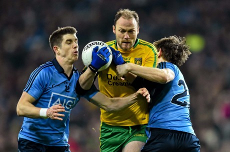 Colm McFadden, Donegal, in action against Emmett O'Conghaile, left, and Michael Fitzsimons of Dublin