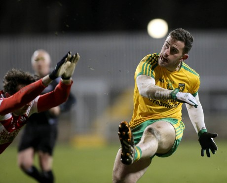 Donegal's Patrick McBrearty kicks a point against Derry.