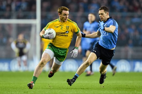 Eamonn Doherty  in action against Dean Rock on Saturday night. Photo: Ramsey Cardy/SPORTSFILE
