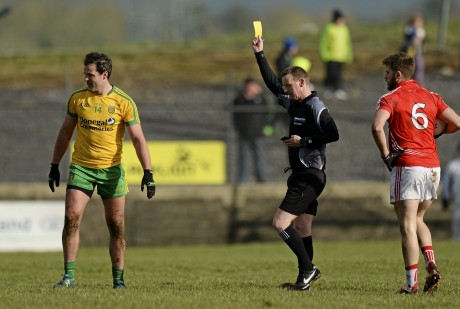 ichael Murphy, Donegal receives a second yellow card from Referee Joe McQuillan after a foul on Eoin Cadogan, right.