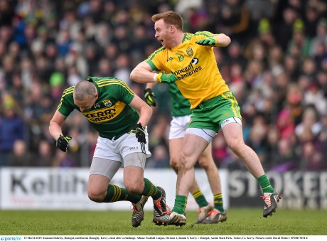 Eamonn Doherty, Donegal, and Kieran Donaghy, Kerry, clash after a challenge.