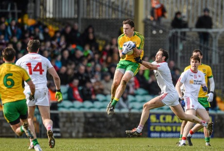 Martin McElhinney, Donegal, in action against Ronan McNabb, Tyrone.