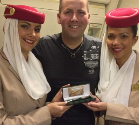 Denis Sweeney with Emirates cabin crew Katy McGee, who has Donegal connections, and Helen Estrada from the Philippines.