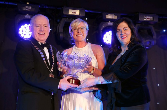 Martin McGettigan, president and Sorcha Ni Domhnaill, chairman of the Donegal Association in Dublin present the 2014 Donegal Person of the Year award to Moya Doherty in the Regency Hotel, Dublin last March. Picture: Declan Doherty.