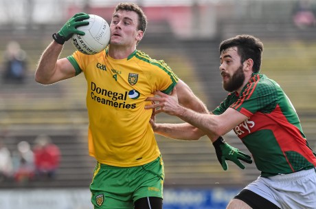 Eamon McGee, Donegal, in action against Kevin McLoughlin, Mayo.