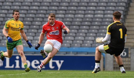rian Hurley shoots past the Donegal goalkeeper Michael Boyle to score Cork's third goal in the 40th minute.
