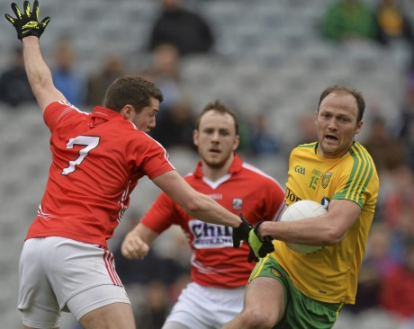 Colm McFadden, Donegal, in action against Tomás Clancy of Cork.