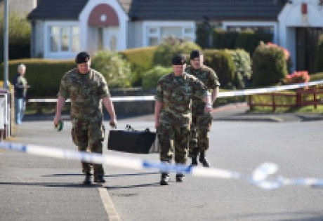 The grenade is removed from the garden at Glencar Park by members of the army explosive ordnance division on Saturday afternoon.