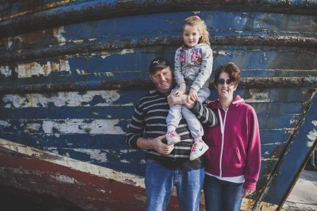 Neilie Kavanagh. fisherman, with daughter Muireann and wife Donna.