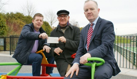 Charity man, Fintan Houston, presenting yet another cheque.
