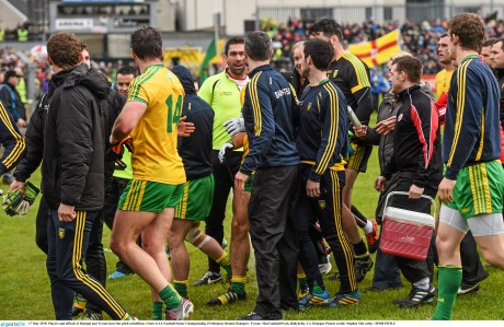 Players and officals of Donegal and Tyrone leave the pitch at halftime.