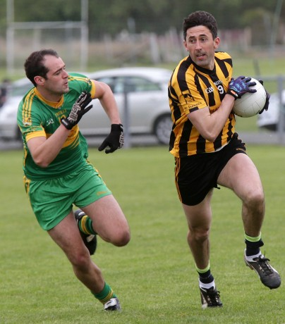 Eunan's Rory Kavanagh gets away from Ardara's Peter Oliver McNelis.