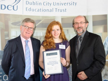 Claire Petersen being presented with her award from Mr. Larry Quinn, Chairman of the Educational Trust Board and Brian MacCraith, President of Dublin City University.