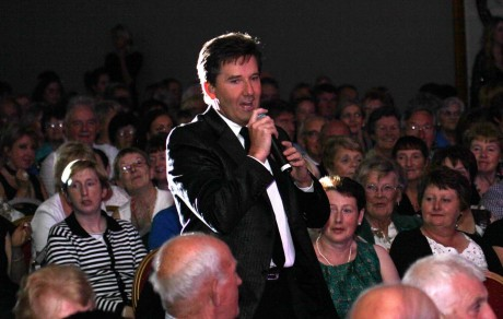 Daniel O'Donnell signs in the crowd in Dungloe at a previous concert.