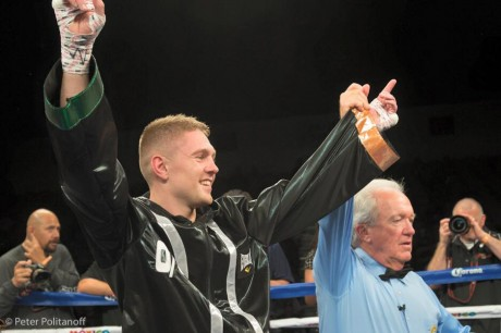 Jason Quigley's arm is held aloft by referee Pat Russell after his win over Joshua Snyder.