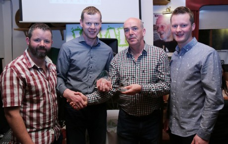 Neily Mc Bride, Derrynamansher (2nd from left) was the overall winner of the WAAR 53k challenge in West Donegal on Saturday and he is pictured receiving his award from Tom Marry, Chairman, Naomh Muire GAA Club. Also included are organisers Brian O'Donaill and Gavin O'Donaill.