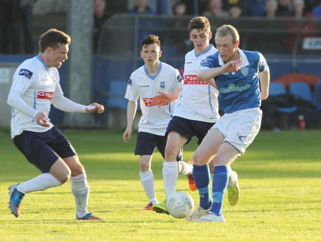 Harps' Raymond Foy has the UCD midfield under pressure. Photo: Donna El Assaad