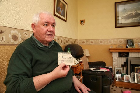 Kevin McFadden holding his match ticket. Photo by Declan Doherty