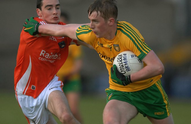 Donegal forward Rory Carr brushes past the challenge of Armagh's Ryan Owens.