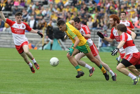 Donegal minor captain Michael Carroll under pressure against Derry. Photo: Donna El Assaad