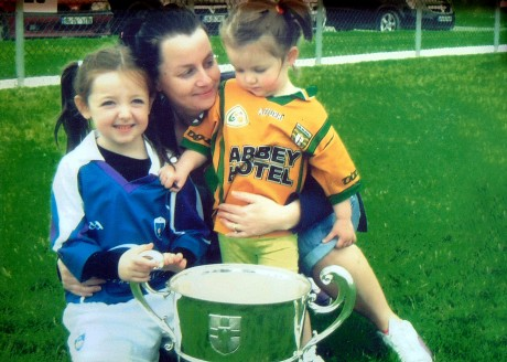 The late Melissa Hamilton with her daughters Jessica (left) and Darcey with the Anglo Celt cup after the Ulster Champions visited the Red Hughs GAA Club in 2012. She passed away less than two months after this picture was taken.