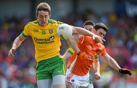 Hugh McFadden, Donegal, in action against Caolan Rafferty, Armagh.