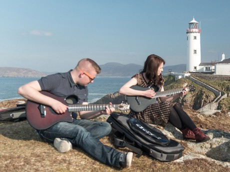 Simon McCafferty and Karen Kelly jamming on Emerald Guitars at Fanad Lighthouse. Photo: Alan McLaughlin