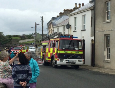 Members of the fire service at the scene of the house fire in Rathmullan on Tuesday.