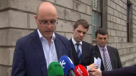 Seamus Hamilton speaking outside the High Court today. He is flanked by his solicitor as well as his late wife's brother, Garvan Connolly (right).