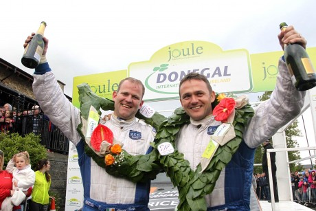 Local men Manus Kelly and Donall Barrett celebrate at the finish ramp after winning the National Rally. Photo: Donna El Assaad