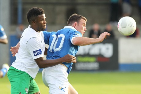 Harps' Garbhan Friel in action against Victor Ekanem of Cabinteely.