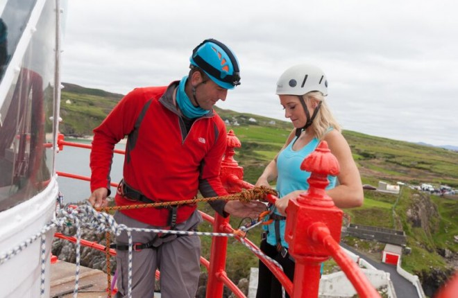 Iain Miller gets Nikki ready to abseil down Fanad Lighthouse. Photos: Declan Devlin