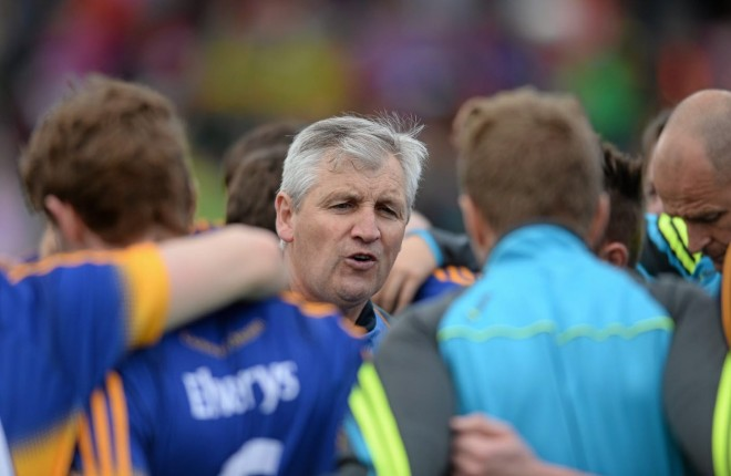 Tipperary manager Charlie McGeever speaks to his players. Photo: Eoin Noonan / SPORTSFILE