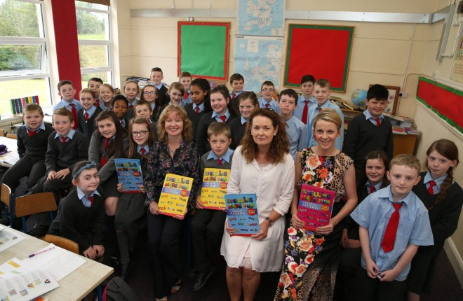 Louise Finnegan with colleagues Susan Doherty, principal, Maeliosa McAteer and pupils of Drumoghill National School.