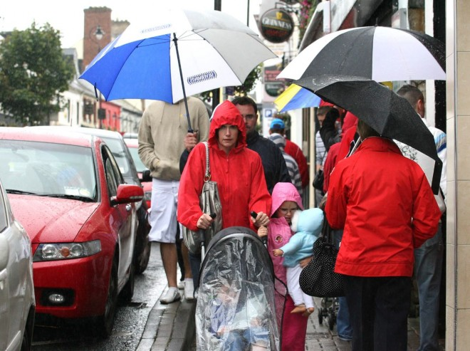 Pedestrians in Letterkenny during the heavy rainfall.