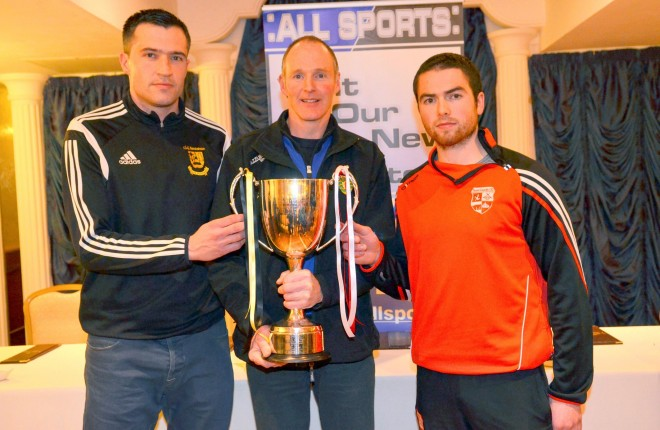 Bundoran captain Tommy Hourihane, the referee Connie Doherty, and the Naomh Colmcille skipper Gerard Curran.