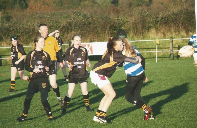 Eimer Alcorn tackling a Dungannon forward with Yasmin Sparks, Sara McBrearty and Chloe Wilkin looking on.
